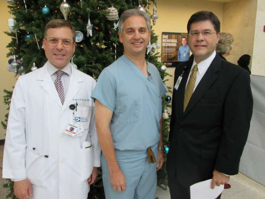 Physician of the Year Jose Ortega (center) with Chief of Staff Howard Hamat (left) and CEO Louis Smith.