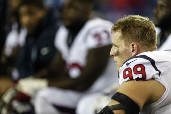 Houston Texans defensive end J.J. Watt sits on the sidelines during the second quarter of an NFL football game against the New England Patriots at Gillette Stadium on Sept. 22, 2016, in Foxborough, Mass.