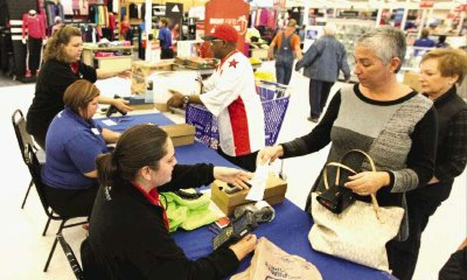 Shoppers return gifts at Academy Sports + Outdoors in Conroe Friday. Photo: Staff Photo By Jason Fochtman