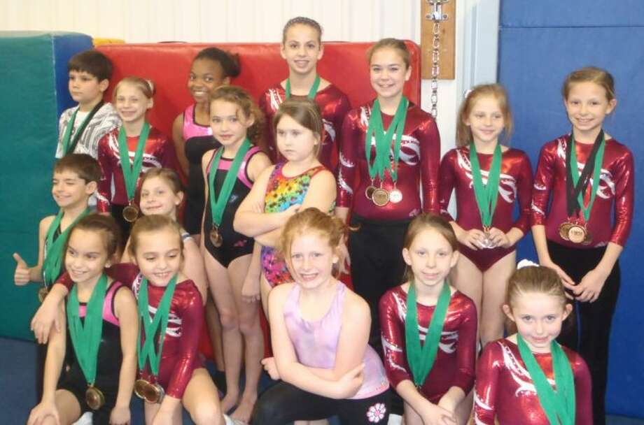 Gymnasts from Tarkington Athletic Center recently competed at a meet in League City, in which they all earned first, second or third place awards.
