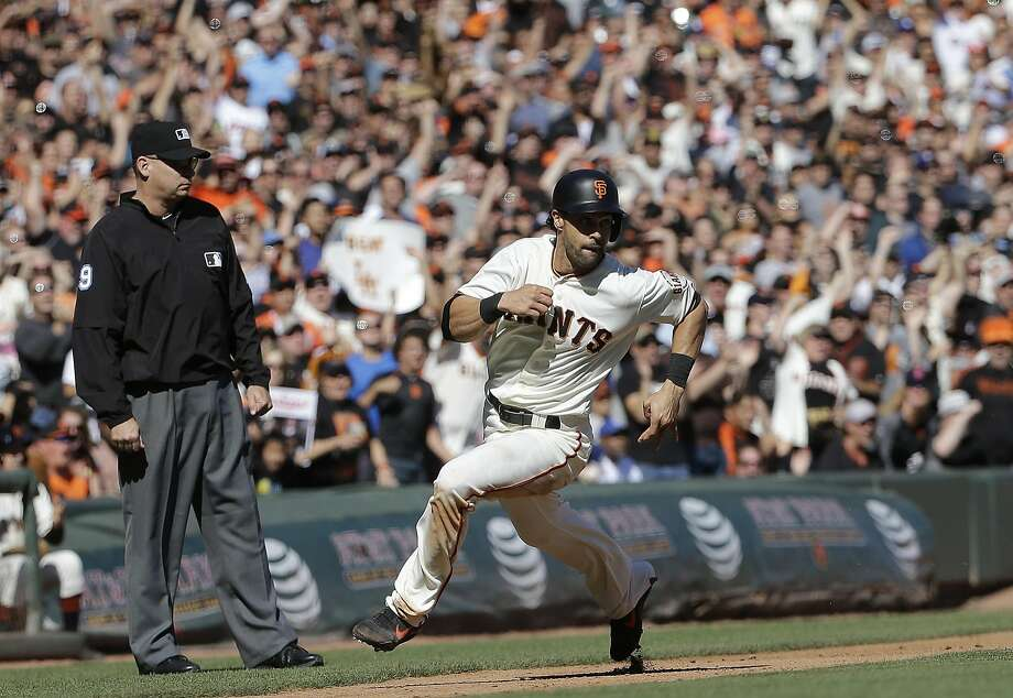 San Francisco Giants' Angel Pagan rounds third base to score against the Los Angeles Dodgers during the seventh inning of a baseball game in San Francisco, Saturday, Oct. 1, 2016. (AP Photo/Jeff Chiu) Photo: Jeff Chiu, Associated Press