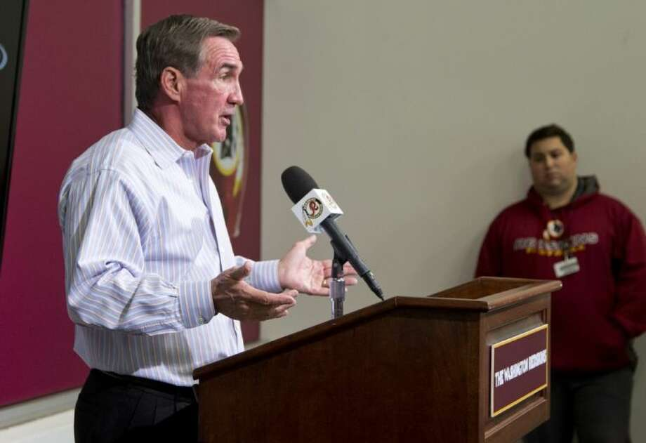 Fired Redskins coach Mike Shanahan reads a statement to reporters. Shanahan's team went 3-13 this season.