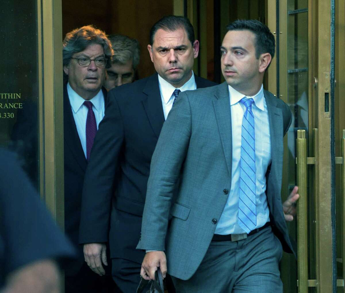 Joseph Percoco, center, the former gatekeeper to Gov. Andrew Cuomo, leaves federal court in New York Thursday, Sept. 22, 2016. Federal authorities accused Percoco of soliciting more than $300,000 in bribes from an energy company and a Syracuse developer. (AP Photo/Craig Ruttle) ORG XMIT: NYCR101