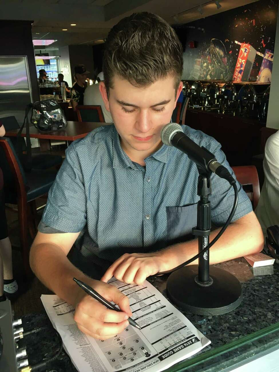 Alex Feuz, Schalmont High School junior, looks over his notes as he prepares for one of his