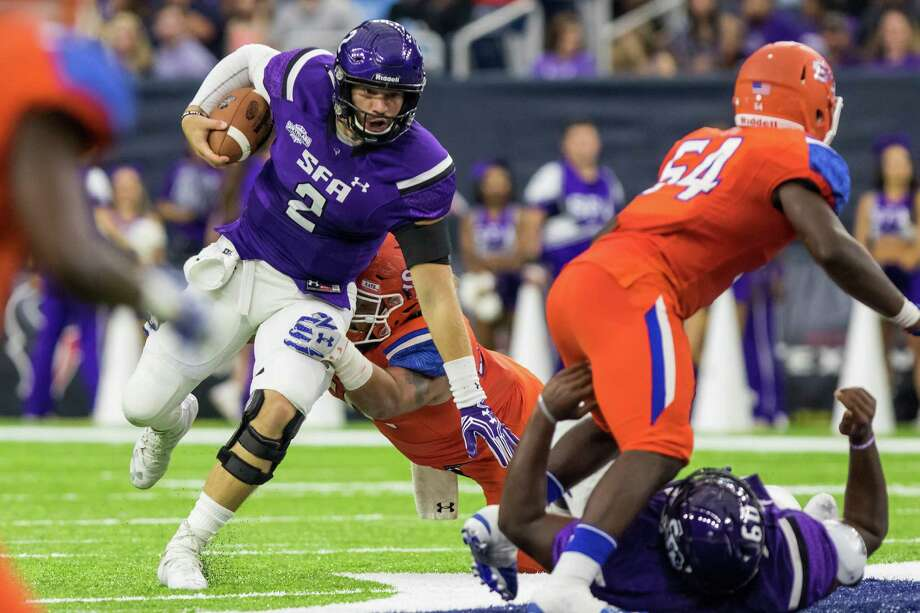 Stephen F. Austin quarterback Zach Conque (2) runs away from the Sam Houston State defender in the Battle of the Piney Woods, NCAA Football Championship Subdivision football game at NRG Stadium on Saturday, October 1, 2016, in Houston. Photo: Joe Buvid, For The Houston Chronicle / © 2016 Joe Buvid