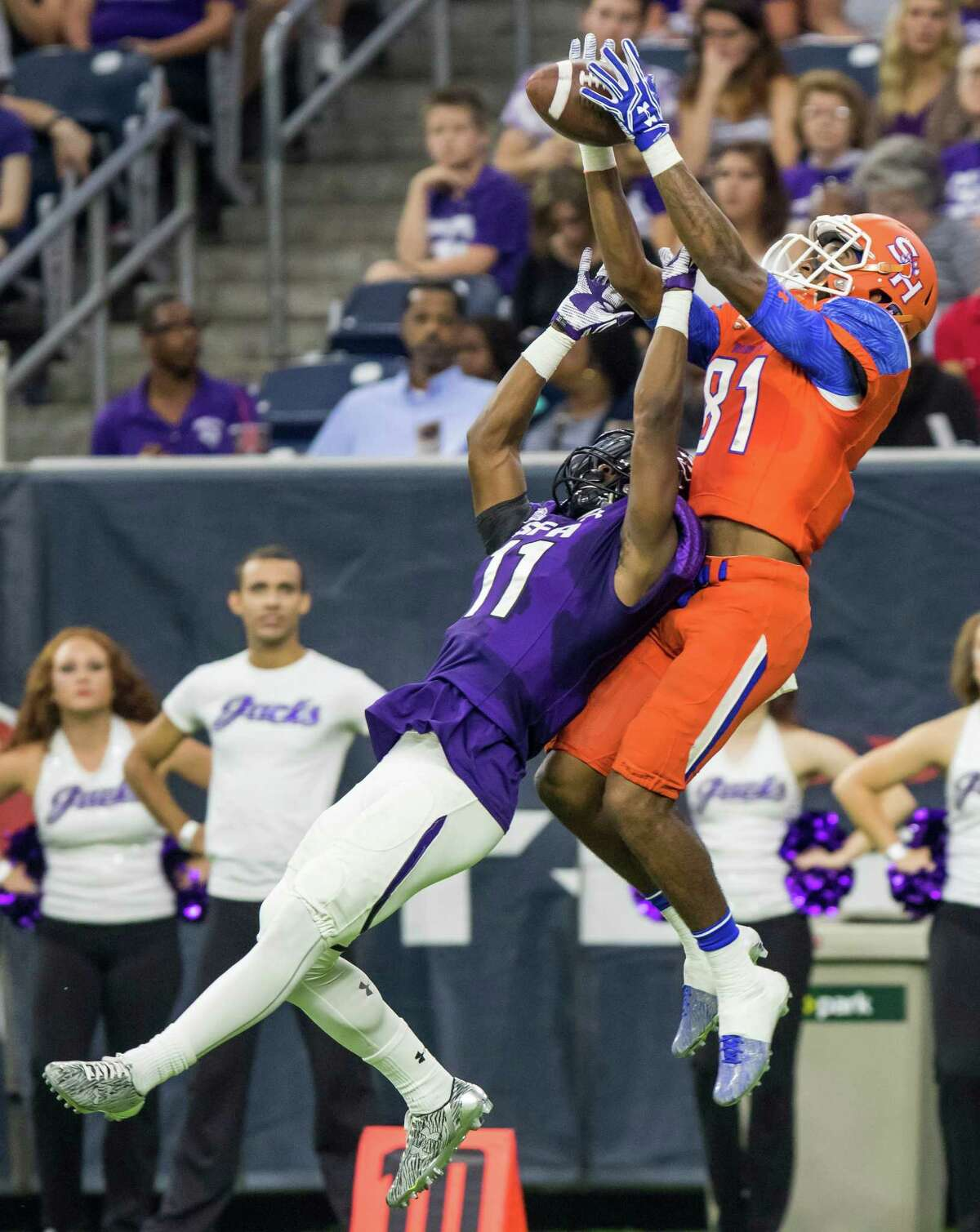 Sam Houston State wideout Nathan Stewart (81) catches a pass over Stephen F. Austin defensive back Aaron Fow (11) in the Battle of the Piney Woods, NCAA Football Championship Subdivision football game at NRG Stadium on Saturday, October 1, 2016, in Houston.