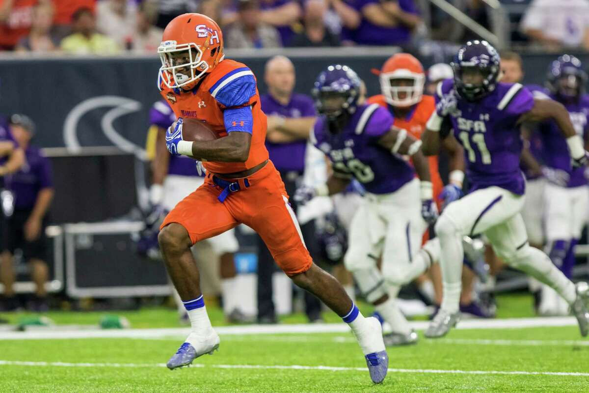 Sam Houston State wideout Nathan Stewart (81) catches a pass for a touchdown in the Battle of the Piney Woods, NCAA Football Championship Subdivision football game at NRG Stadium on Saturday, October 1, 2016, in Houston.