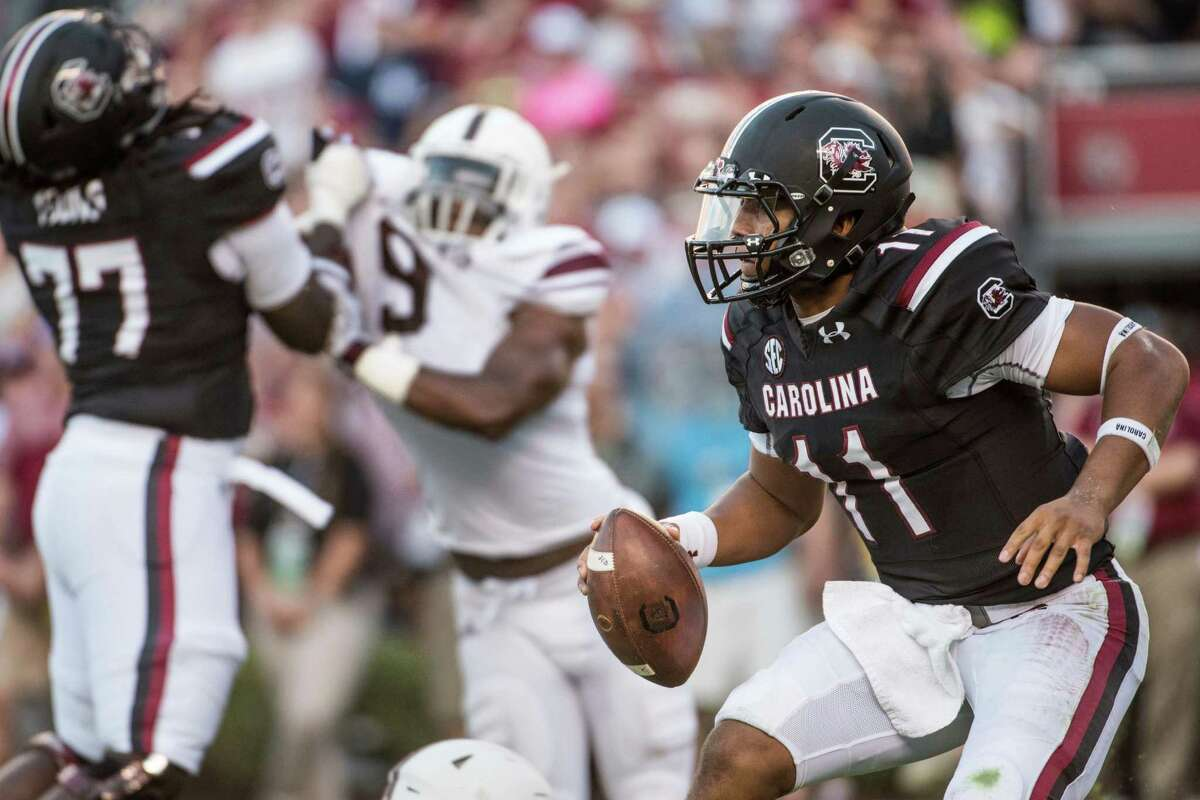 South Carolina quarterback Brandon McIlwain (11) scrambles against the Texas A&M defense during the second half of an NCAA college football game, Saturday, Oct. 1, 2016, in Columbia, S.C. Texas A&M defeated South Carolina 24-13. (AP Photo/Sean Rayford)