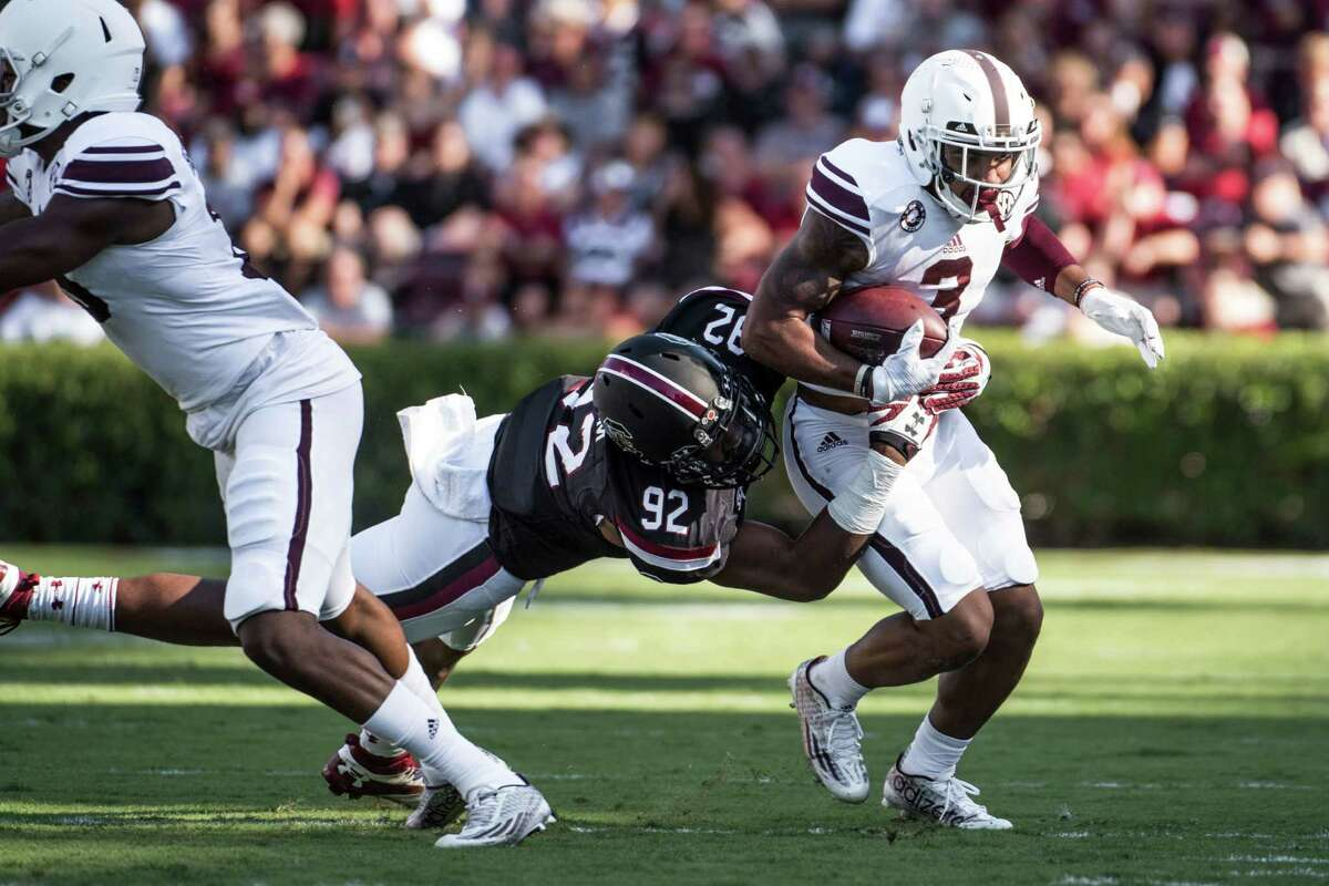 Texas A&M wide receiver Christian Kirk (3) attempts to elude South Carolina defensive lineman D.J. Wonnum (92) during the first half of an NCAA college football game, Saturday, Oct. 1, 2016, in Columbia, S.C. Texas A&M defeated South Carolina 24-13. (AP Photo/Sean Rayford)