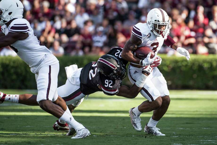 Texas A&M wide receiver Christian Kirk (3) attempts to elude South Carolina defensive lineman D.J. Wonnum (92) during the first half of an NCAA college football game, Saturday, Oct. 1, 2016, in Columbia, S.C. Texas A&M defeated South Carolina 24-13. (AP Photo/Sean Rayford) Photo: Sean Rayford, Associated Press / The Associated Press