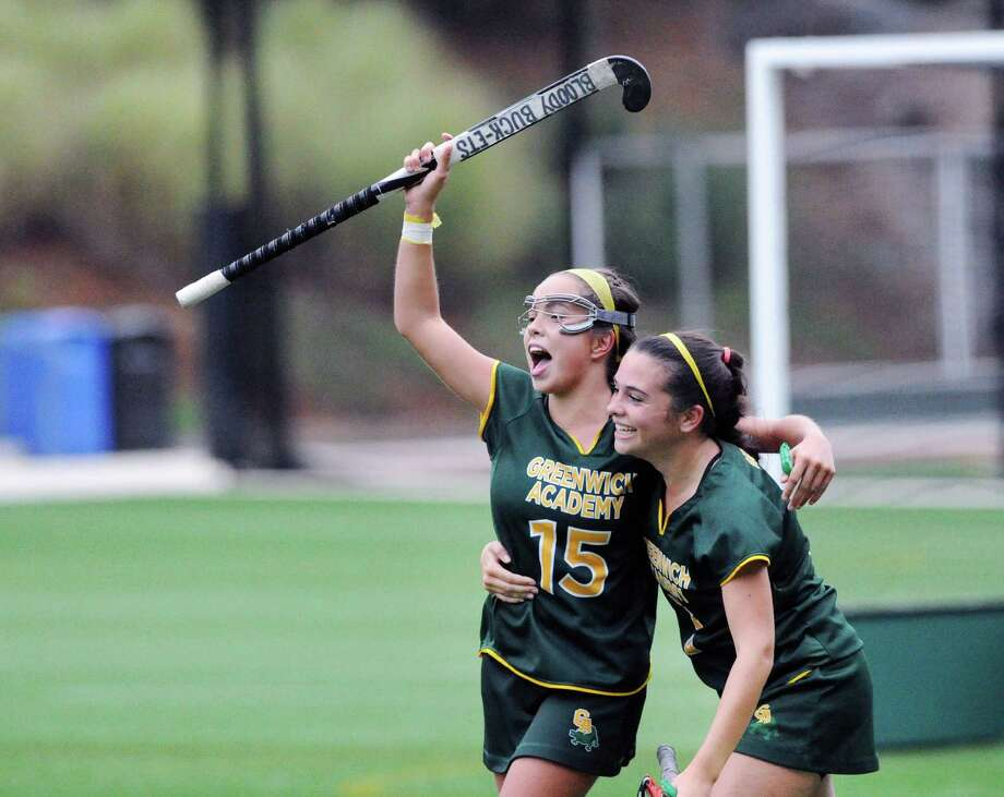 Greenwich Academy's Sofi Viola, left, and Lucy Burke celebrate the Gators' win over Hotchkiss. Photo: Bob Luckey Jr. / Hearst Connecticut Media / Greenwich Time