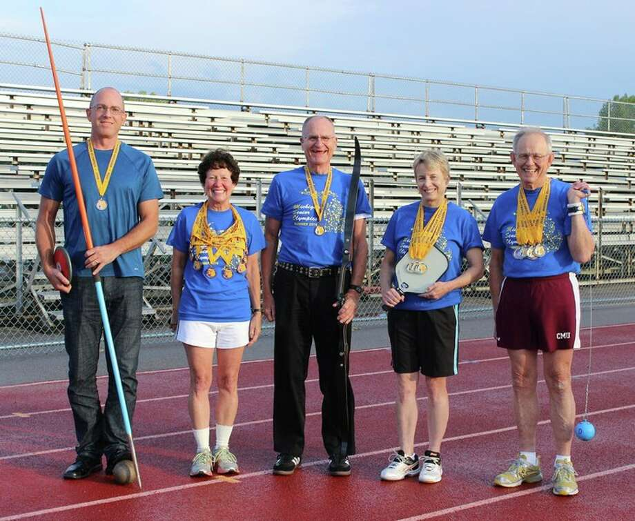 Photo by Marcia Dilling Seven Midland athletes won medals at the 2016 Michigan Senior Olympics  recently at Oakland University and other Oakland County locations.  Pictured, from left, are Robert Appell, Becky Wieland, Howard King, Gail Kantak, and Wendell Dilling. Not pictured are James Hoogerhyde and Willis Pennington.