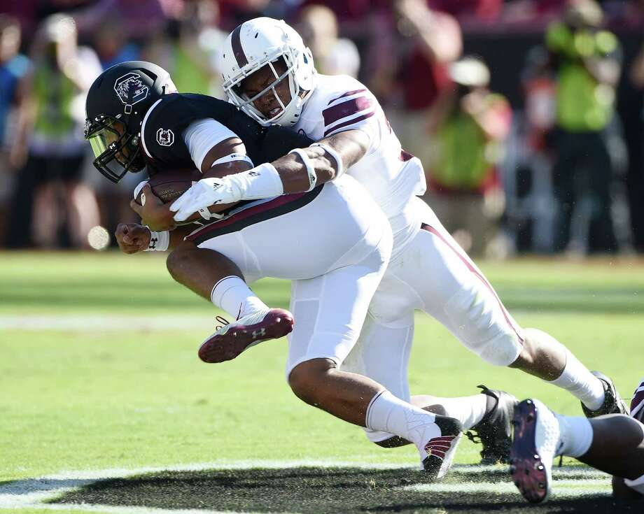 Quarterback Brandon McIlwain of the South Carolina Gamecocks is brought down by linebacker Shaan Washington of the Texas A&M Aggies on Oct. 1, 2011 at Williams-Brice Stadium in Columbia. Photo: Todd Bennett /Getty Images / 2016 Getty Images