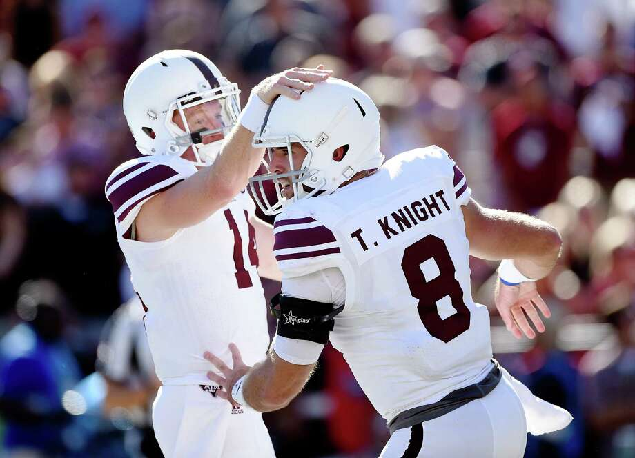 COLUMBIA, SC - OCTOBER 1: Quarterback Trevor Knight #8 of the Texas A&M Aggies is congratulated by quarterback Connor McQueen #14 after scoringa touchdown against the South Carolina Gamecocks on October 1, 2011 at Williams-Brice Stadium in Columbia, South Carolina. (Photo by Todd Bennett/GettyImages) Photo: Todd Bennett, Stringer / Getty Images / 2016 Getty Images