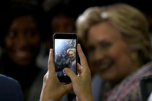 CORAL SPRINGS, FL - SEPTEMBER 30:  Democratic presidential nominee former Secretary of State Hillary Clinton takes a selfie with a supporter during a campaign rally at Coral Springs Gymnasium on September 30, 2016 in Coral Springs, Florida. Hillary Clinton is campaigning in Florida.  (Photo by Justin Sullivan/Getty Images)