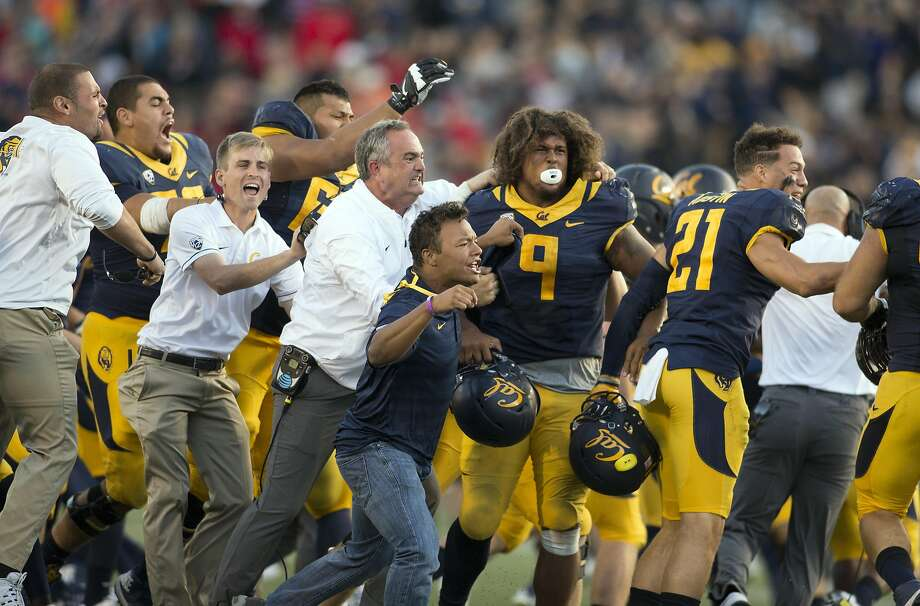 California players and coaches celebrate their victory over Utah in a Pac-12 football game, on Saturday, Oct. 1, 2016 in Berkeley, Calif. Cal won, 28-23. Photo: D. Ross Cameron, Special To The Chronicle
