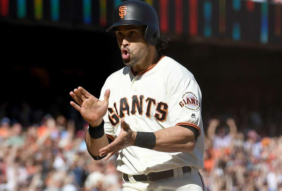 SAN FRANCISCO, CA - OCTOBER 01:  Angel Pagan #16 of the San Francisco Giants celebrates after scoring on a throwing error from Justin Turner #10 of the Los Angeles Dodgers in the bottom of the seventh inning at AT&T Park on October 1, 2016 in San Francisco, California.  (Photo by Thearon W. Henderson/Getty Images) Photo: Thearon W. Henderson, Getty Images