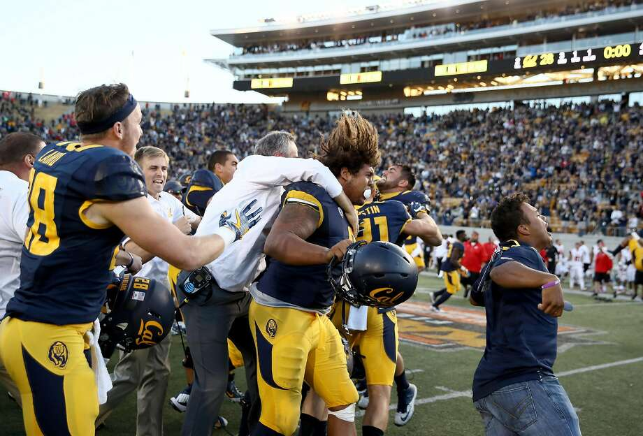 BERKELEY, CA - OCTOBER 01:  Head coach Sonny Dykes and James Looney #9 of the California Golden Bears celebrate with teammates after they beat the Utah Utes at California Memorial Stadium on October 1, 2016 in Berkeley, California.  (Photo by Ezra Shaw/Getty Images) Photo: Ezra Shaw, Getty Images