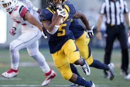 California running back Tre Watson (5) looks for open field during the third quarter of a football game against Utah, on Saturday, Oct. 1, 2016 in Berkeley, Calif.