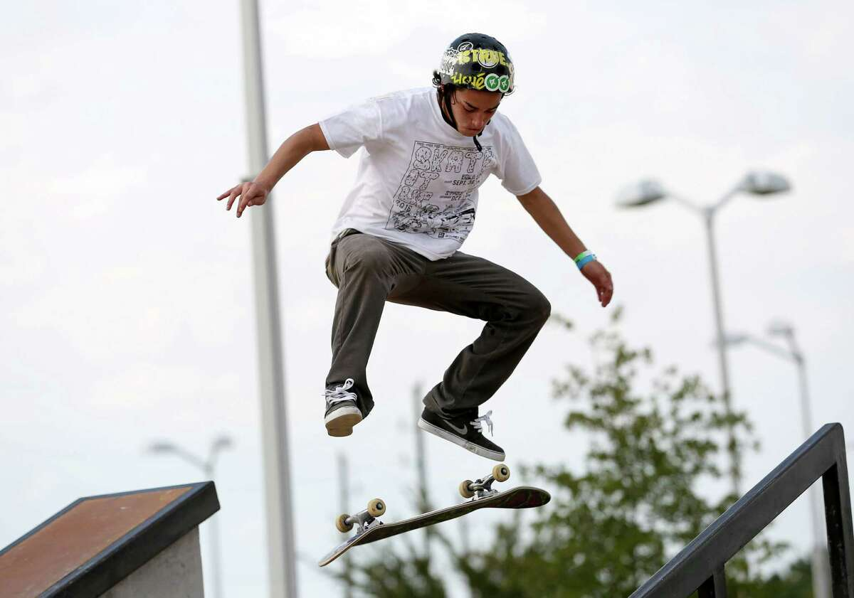 The Skate It Up skateboard competition 15-17 Years Old division finalists performs his moves at North Houston Skate Park Saturday, Oct. 1, 2016, in Houston. Santino Fernandez took the first place title in this division.