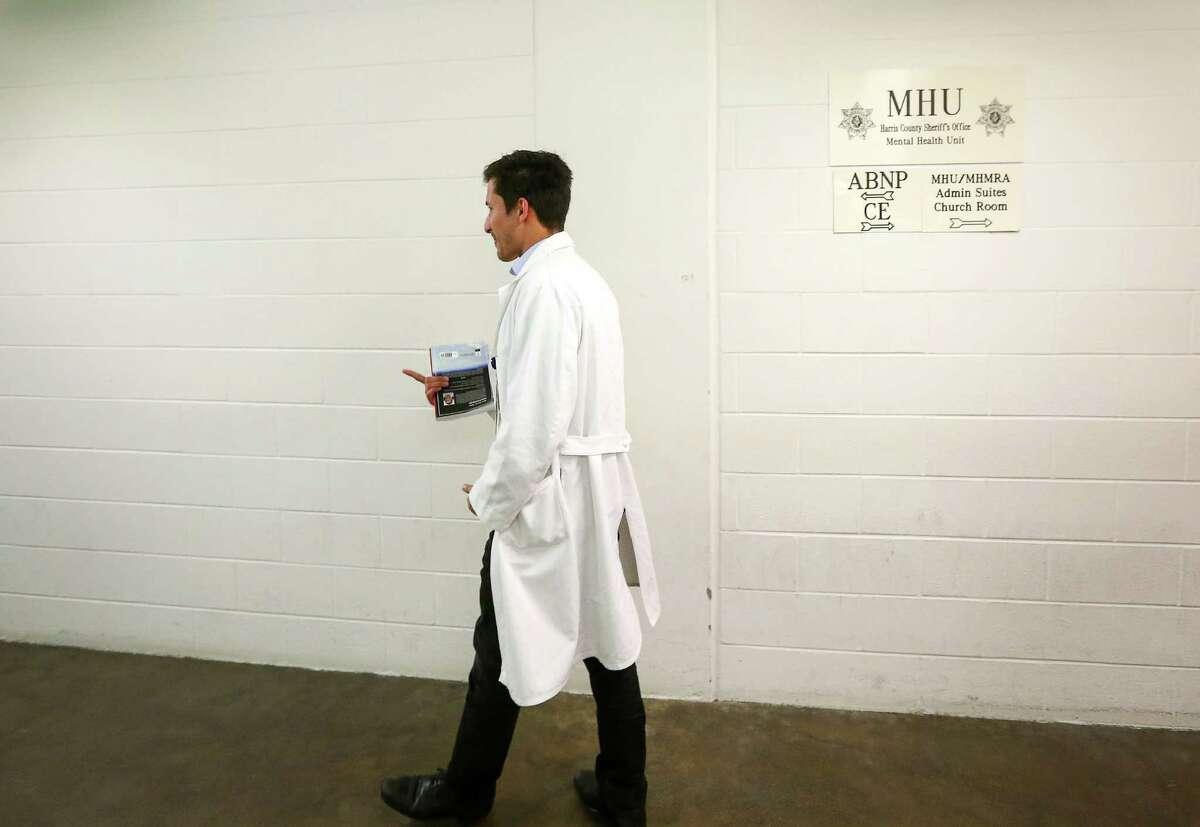 Dr. Josef Witt-Doerring walks through the halls in the mental health unit at the Harris County Jail, Friday, Sept. 30, 2016, in Houston. Witt-Doerring is a second-year psychiatry resident. ( Jon Shapley / Houston Chronicle )