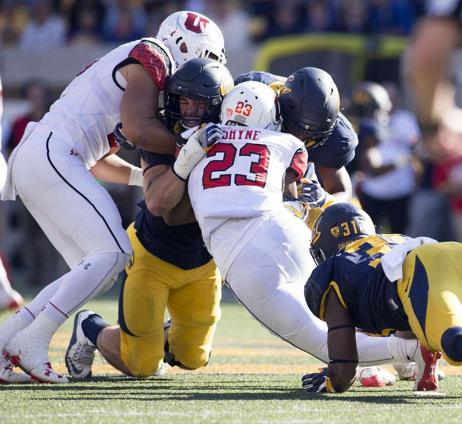 Utah running back Armand Shyne runs into a wall of California defenders during the second quarter of a football game, on Saturday, Oct. 1, 2016 in Berkeley, Calif. Photo: D. Ross Cameron, Special To The Chronicle