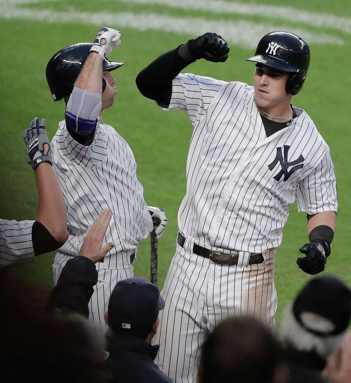 New York Yankees' Tyler Austin, right, celebrates with Mark Teixeira after hitting a solo home run against the Baltimore Orioles during the seventh inning of a baseball game, Saturday, Oct. 1, 2016, in New York. The Yankees won 7-3. (AP Photo/Julie Jacobson) ORG XMIT: NYJJ114
