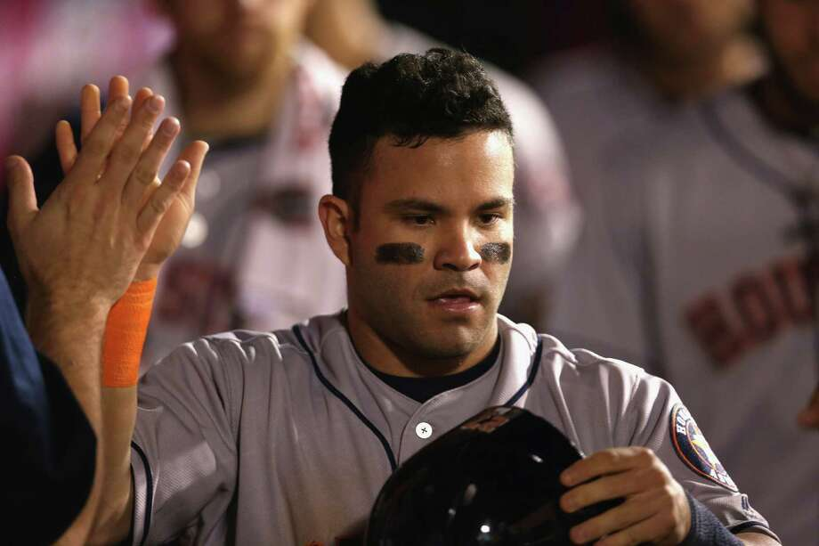 ANAHEIM, CALIFORNIA - OCTOBER 01:  Jose Altuve #27 of the Houston Astros celebrates in the dugout after scoring a run against the Los Angeles Angels of Anaheim in the seventh inning at Angel Stadium of Anaheim on October 1, 2016 in Anaheim, California. Photo: Stephen Dunn, Getty Images / 2016 Getty Images
