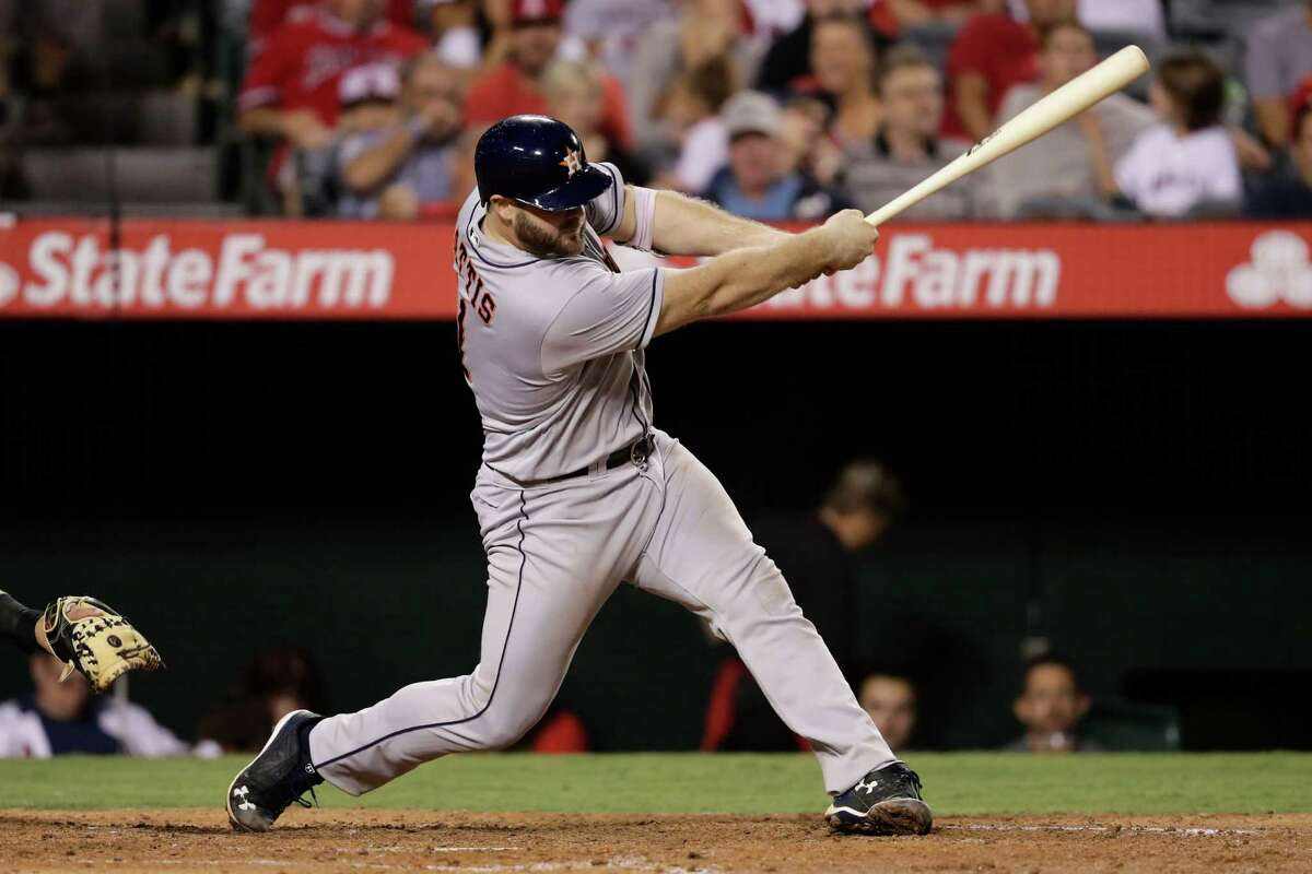 Houston Astros' Evan Gattis hits a RBI single during the seventh inning of a baseball game against the Los Angeles Angels, Saturday, Oct. 1, 2016, in Anaheim, Calif. (AP Photo/Jae C. Hong)