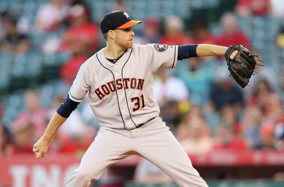 ANAHEIM, CALIFORNIA - OCTOBER 01:  Colin McHugh #31 of the Houston Astros Throws a pitch in the first inning against the Los Angeles Angels of Anaheim at Angel Stadium of Anaheim on October 1, 2016 in Anaheim, California. Photo: Stephen Dunn, Getty Images / 2016 Getty Images