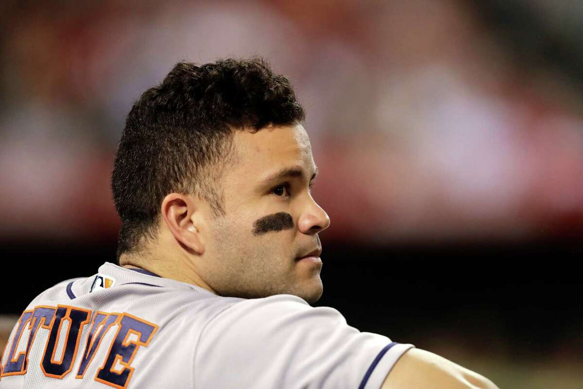 Houston Astros' Jose Altuve watches from the dugout during the fifth inning of a baseball game against the Los Angeles Angels, Saturday, Oct. 1, 2016, in Anaheim, Calif. (AP Photo/Jae C. Hong)