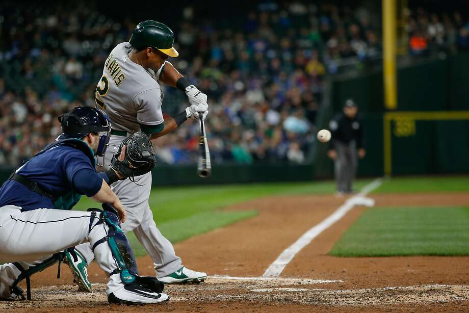 SEATTLE, WA - OCTOBER 01:  Khris Davis #2 of the Oakland Athletics hits an RBI double in the third inning  against the Seattle Mariners at Safeco Field on October 1, 2016 in Seattle, Washington.  (Photo by Otto Greule Jr/Getty Images) Photo: Otto Greule Jr, Getty Images