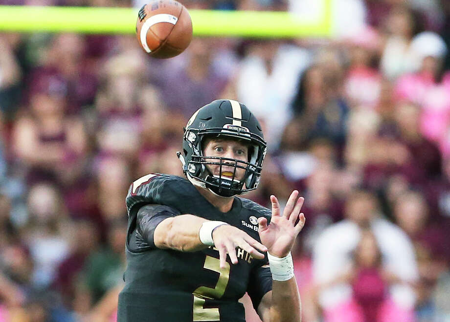 Bobcat quarterback Tyler Jones throws to a receiver in the first half as Texas State hosts the University of the Incarnate Word at Bobcat Stadium on October 1, 2016. Photo: TOM REEL, STAFF / SAN ANTONIO EXPRESS-NEWS / 2016 SAN ANTONIO EXPRESS-NEWS