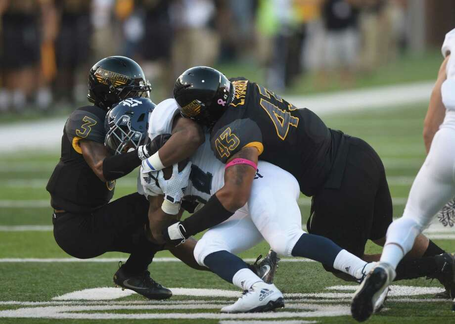 Southern Mississippi's Cornell Armstrong, left, and LaDariusHarris make a tackle against a Rice player during an NCAA college football game Saturday, Oct. 1, 2016, in Hattiesburg, Miss. (Susan Broadbridge/Hattiesburg American via AP) Photo: Susan Broadbridge, MBO / Hattiesburg American