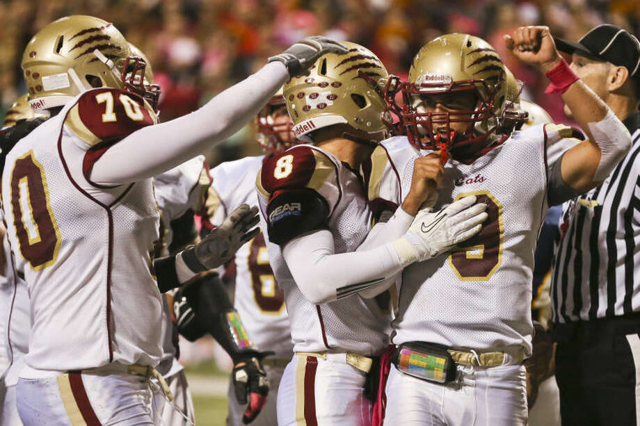 Cy Woods' Nick Hooper celebrates with teammates after scoring a touchdownagainst Cy Ranch on Saturday at the Berry Center. The Wildcats are in line for a playoff spot with three to play. Photo: Michael Minasi