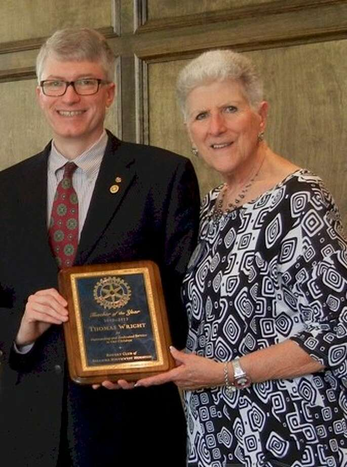 """Bellaire/Southwest Rotary President Judy Harwell presents the club's """"2013 Teacher of the Year"""" award to Tom Wright of Bellaire's Episcopal High School. Photo: Submitted"""