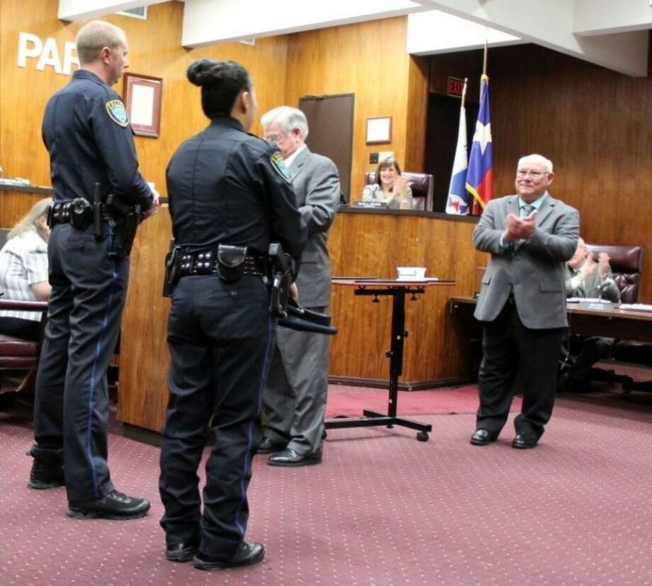 Deer Park Assistant Police Chief Ken Findley presented Police Officers Kai Zheng and Scott Baumann with a Life Saving Award at a council meeting held Tuesday (Oct. 19). Photo: KRISTI NIX