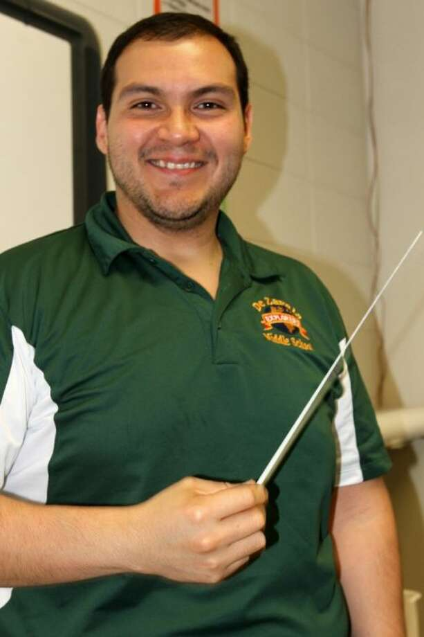 De Zavala Band Director Reynaldo Benitez gets his middle school band students ready for practice. Photo: Bruce Stone