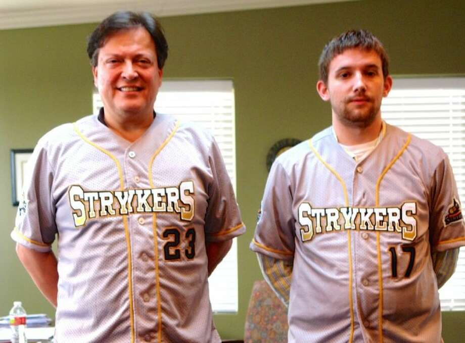 Strykers Owner and General Manager Ramiro Lozano, left, and Assistant General Manager Lance Drake show off the Strykers' new jerseys. Photo: Staff Photo By Jon Poorman