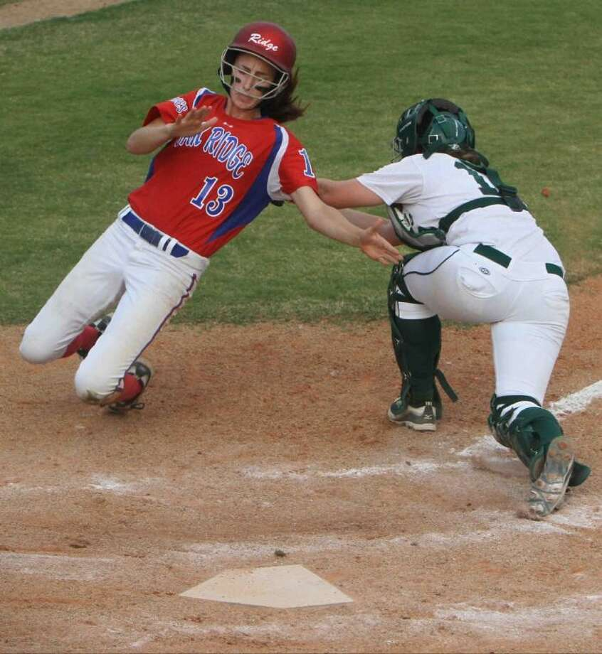Oak Ridge's Amanda Cunniff is tagged out at the plate by The Woodlands catcher Brittany Kellett. To view or order this photo, or others like it, visit: HCNPics.com.