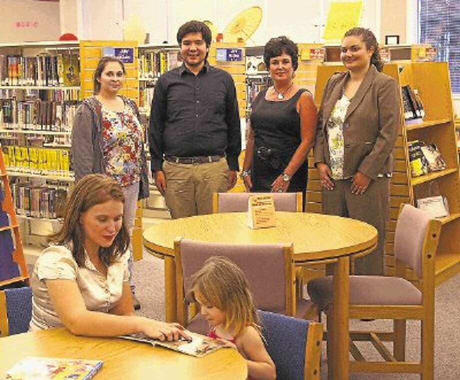 Elementary School/GED tutor Elizabeth Lawlis.(seated) works with a student. Standing are Elementary School Tutor Roxanna Rodriguez (left) , High School Tutor Raphael Sepulveda, Sales Director Linda Horan and Ace My Course Founder/CEO Jennifer Whitaker. Photo: Submitted Photo / @WireImgId=2634853