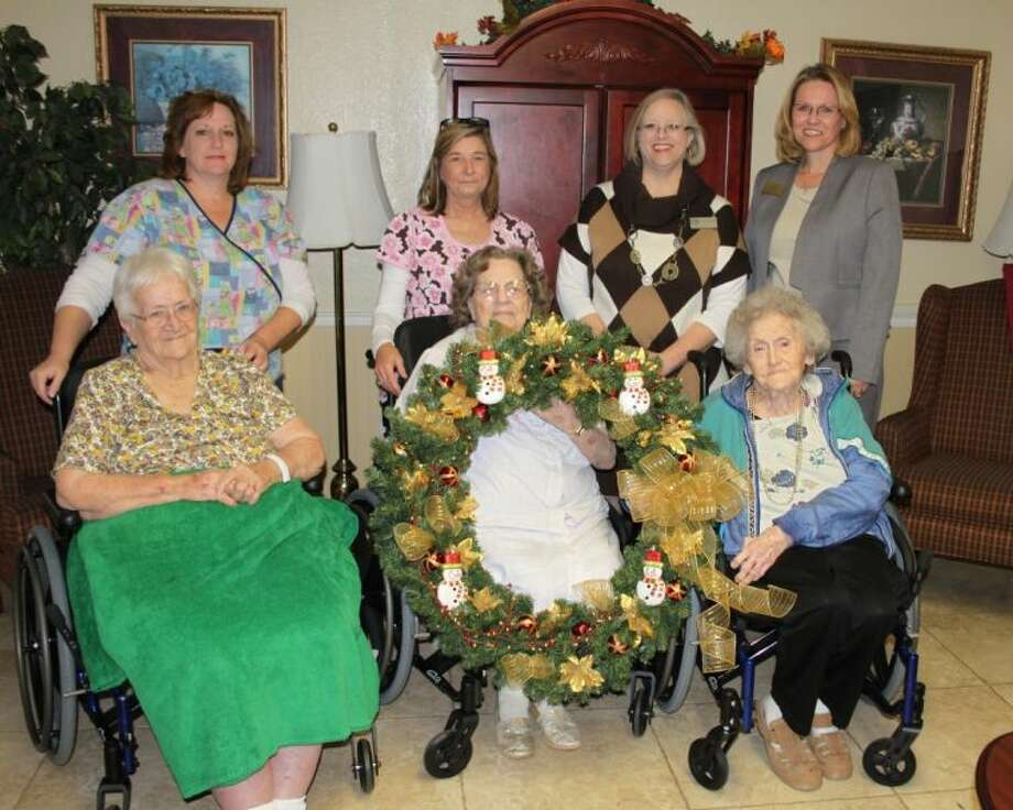 Residents and staff at Cleveland Health Care Center are preparing for their Holiday Open House, which will be held on Dec. 5 and will have a holiday wreath contest throughout the day. Local businesses are invited to decorate a wreath for display at the facility. Pictured are (front row, left to right) Mary Fields, Vanara McDonald, Betty Scambray, (back row) Karen Morgan, Donna Birdwell, Karen Buck and Pace-Stancil Funeral Home's Frieda Joyce. The wreath being held by Mrs. McDonald is the one prepared by Pace-Stancil Funeral Home. Photo: VANESA BRASHIER