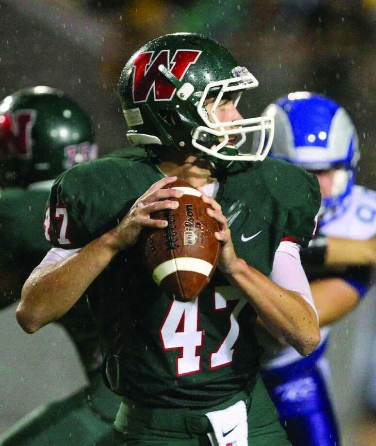 The Woodlands quarterback Matt Bonaguidi drops back to pass against Monterrey Prepa Tec. To view or purchase this photo and others like it, visit HCNpics.com.