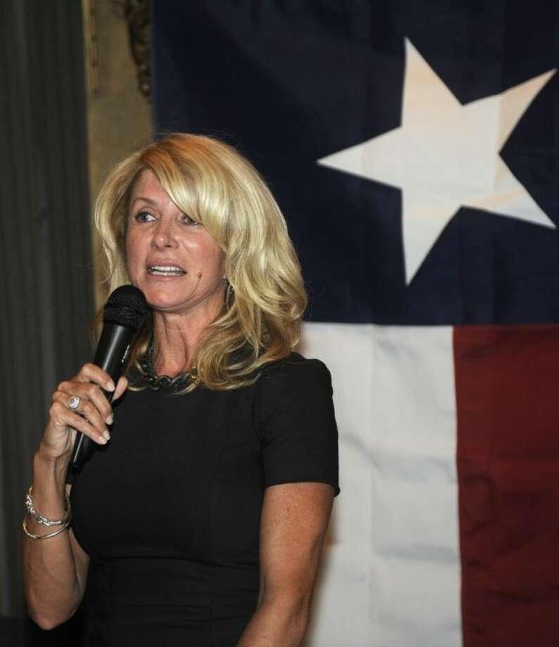 In this July 25 file photo, Democrat Texas State Senator Wendy Davis speaks at a fundraiser in Washington.