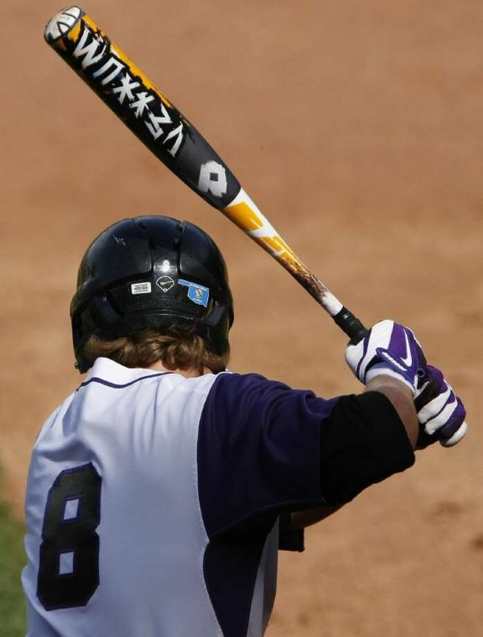 Big 12 baseball teams wore an Oklahoma sticker on their helmet in support of the Moore tornado tragedy victims as displayed on Kansas State's Lance Miles' helmet during the Big 12 Conference NCAA college baseball tournament game at the Chickasaw Bricktown Ballpark in Oklahoma City Thursday.