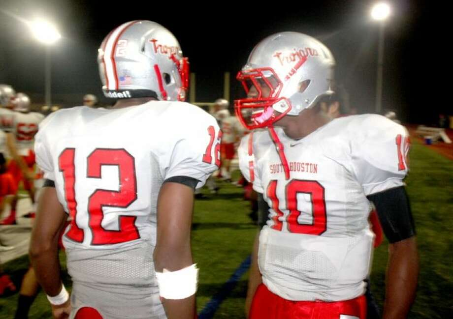 Quarterback James Davis (10) and receiver Elton Dyer congratulate each other after the dramatic 99-yard touchdown pass that iced the big district road win Friday night. It was a South Houston team's first district win over a non-Pasadena ISD opponent since 2007. Photo: Robert Avery