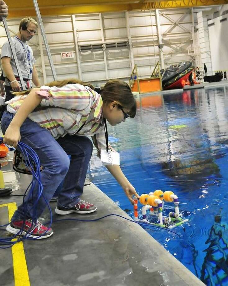 Samantha Ramirez from Devine Middle School tests Nautilus, the underwater robot she and her partner Mason Honig (not pictured) built for the Robotics, Ocean, Microgravity Explorers (ROME) Challenge at the NASA-Johnson Space Center. Photo: Jeannie Peng-Armao