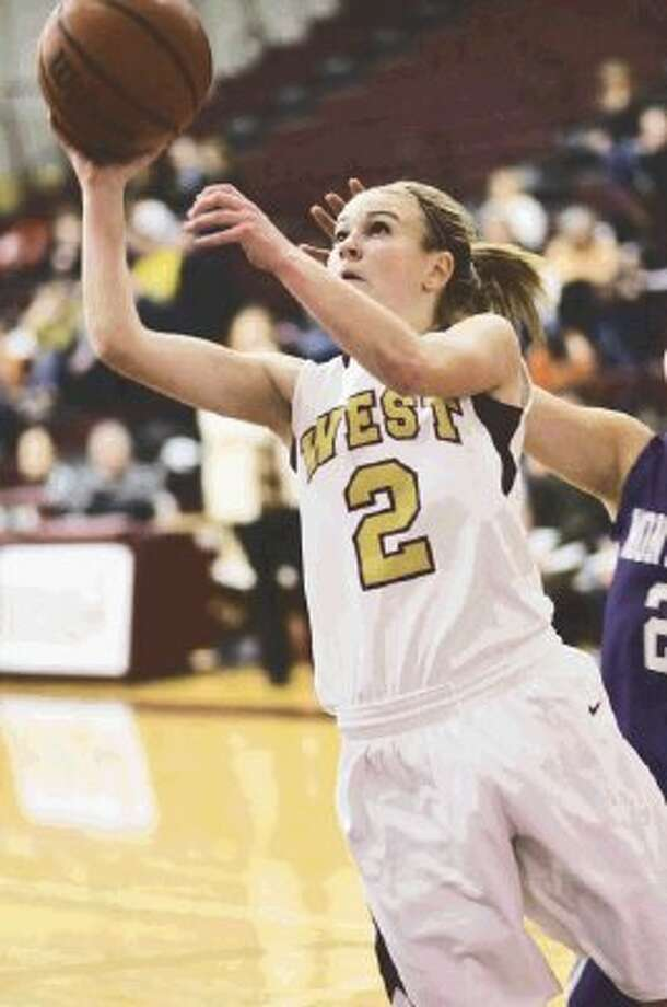 MiCayla Kunz hits 2 of her team high 15 points on a fast break. Kunz had seven steals in the game.