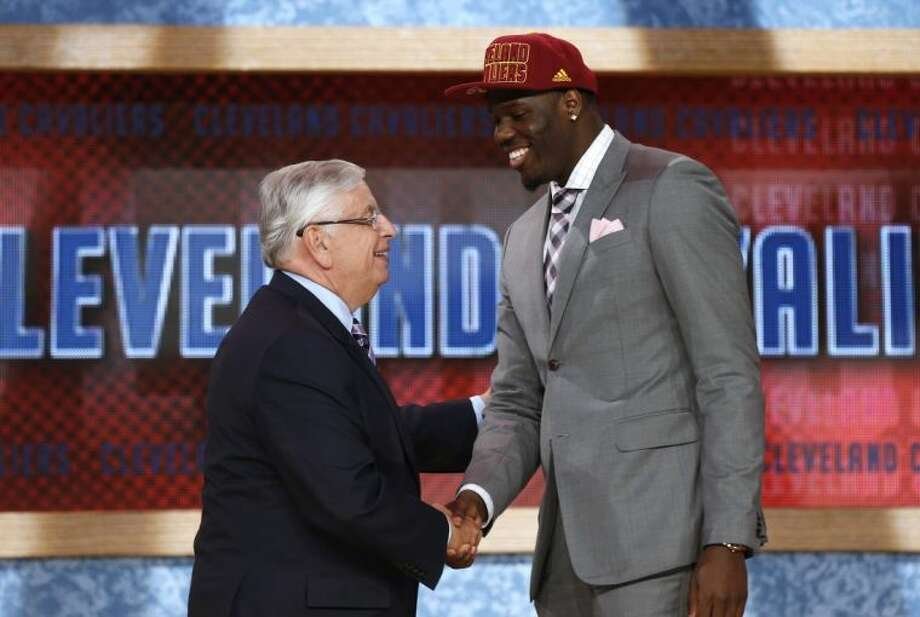 NBA Commissioner David Stern, left, shakes hands with UNLV's Anthony Bennett, who was selected first overall by the Cleveland Cavaliers in the NBA draft.