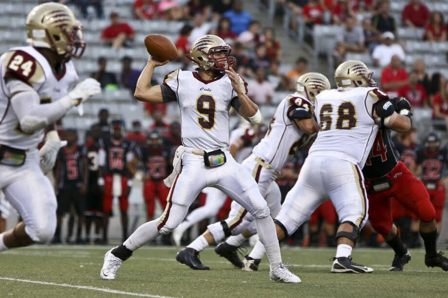 Cy Woods quarterbackNick Hooper leads the Wildcats into the 2014 season opener against Klein Collins. Photo: Michael Minasi